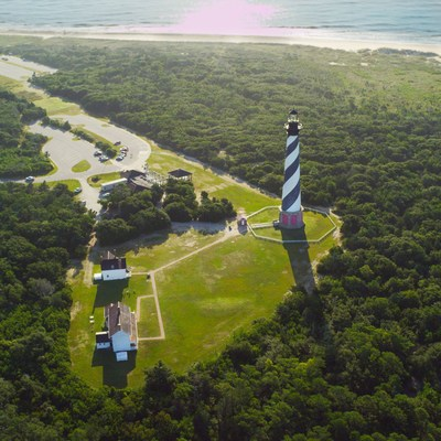 You can now enjoy the view atop Cape Hatteras Lighthouse from the comfort of home or your mobile phone, thanks to a new partnership between the National Park Service, Outer Banks Visitors Bureau, OBX Forever and Surfline. A new webcam atop America's tallest lighthouse is the first of three to be installed at national park sites on the Outer Banks.