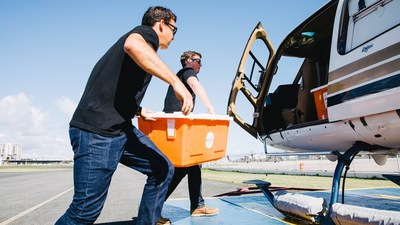 Direct Relief staff load critical medicines and supplies onto a helicopter in San Juan following Hurricane Maria in 2017. The medicines went to Health ProMed Health Center on the island of Vieques. (Photo by Donnie Hedden for Direct Relief)