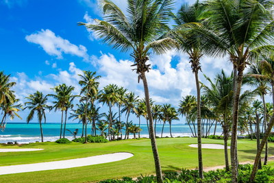 Coconut trees and views of the ocean and El Yunque rainforest are some of the visual delights that accompany a tropical golf experience in Puerto Rico. (Photo courtesy of Wyndham Grand Rio Mar Golf & Beach Resort)