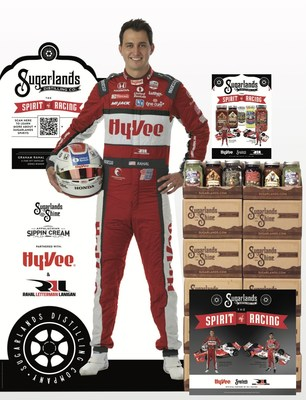 Hy-Vee point of sale material featuring Graham Rahal and Takuma Sato.