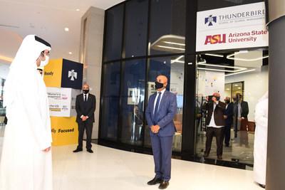 Thunderbird's Dean, Dr. Sanjeev Khagram, greets Sheikh Maktoum bin Mohammed at the entrance to Thunderbird Innovation Center within DIFC Innovation Hub in Dubai.